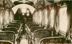 INTERIOR OF AN IMPERIAL AIRWAYS PASSENGER AEROPLANE  wicker seats looking front