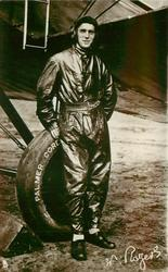 pilot W. ROGERS standing by airplane wheel  marked PALMER CORP