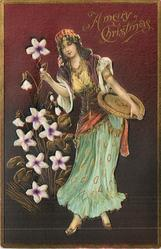A MERRY CHRISTMAS  applique of girl with tray under left arm, touching violet inset with her left hand