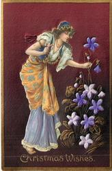 CHRISTMAS WISHES  applique of girl bending to touch violet inset with her left hand
