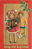 CHRISTMAS GREETINGS  at bottom, girl with fur muff holds doll & holly, boy behind with snowballs