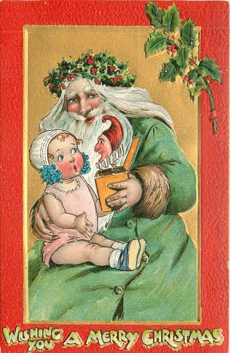 WISHING YOU A MERRY CHRISTMAS   green robed Santa startles child on lap with jack-in-a-box