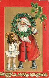 WISHING YOU A MERRY CHRISTMAS   Santa peers through holly wreath at girl in white