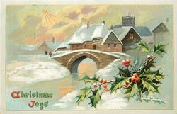 CHRISTMAS JOYS  snow scene village behind bridge, holly front right