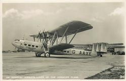 HENGIST (on aircraft) G-AAXE, AN IMPERIAL AIRWAYS LINER OF THE HERACLES CLASS  at airport, facing left