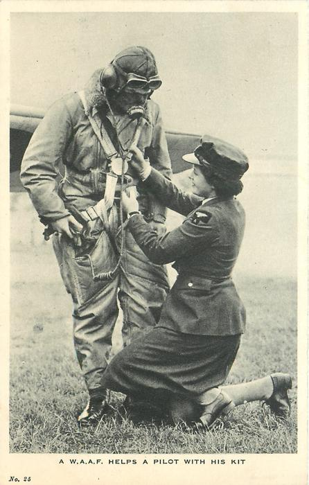 A W.A.A.F. HELPS A PILOT WITH HIS KIT