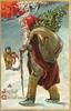 A JOYFUL CHRISTMAS  brown suited red robed Santa walks left with stick, tree and sack