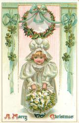 A MERRY CHRISTMAS  bonnetted child in white has bunch of white roses held with both hands
