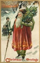 CHRISTMAS GREETINGS  Santa has tree on his shoulder, cane in right hand, moves left, mother & child behind