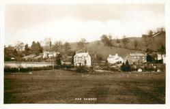 FAR SAWREY  sheep distant in field in front of many houses
