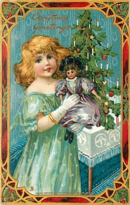 CHRISTMAS GREETINGS  girl in green holds large doll in front of Xmas tree