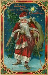 WISHING YOU A MERRY CHRISTMAS  Santa walks forward carrying sack, tree & stick, star above