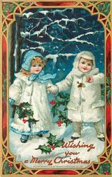 WISHING YOU A MERRY CHRISTMAS  two children hold hands in snow, holly about