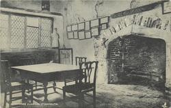GREYFRIARS CLOISTERS, GT. YARMOUTH  room with table & prominent fireplace