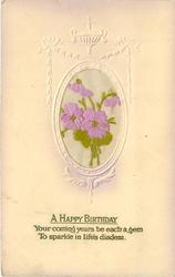 A HAPPY BIRTHDAY oval inset purple flowers with green foliage, set in embossed nouveau design