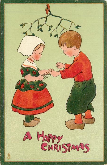 A HAPPY CHRISTMAS  boy plays cat's cradle with string girl has between hands under mistletoe