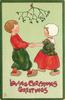 CHRISTMAS GREETINGS  boy left holds both hands of girl right, under mistletoe