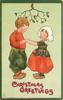 LOVING CHRISTMAS GREETINGS  boy and girl hold hands under mistletoe