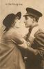 IN THE FIRING LINE  sweetheart caresses face of soldier in uniform, he embraces her