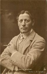 MR. LEWIS WALLER arms folded across chest, cigarette in holder