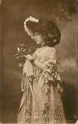 MISS GRACE LANE  three quarter length costumed study, holding bouquet