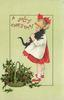 A JOLLY CHRISTMAS  girl holds black cat, holly below left
