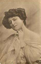 MISS HILDA HANBURY hands under chin, left index touches cheek, facing slightly left, looking front