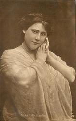 MISS LILY HANBURY off shoulder dress, hands together at left side of her face