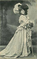 MISS GRACE LANE  full length costume pose, facing right, holding long cane, looking front