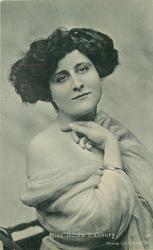 MISS HILDA HANBURY  facing slightly right, hands under chin, bare right shoulder