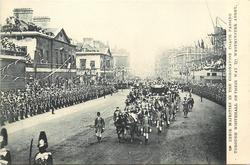 THEIR MAJESTIES IN THE CORONATION COACH PASSING THROUGH WHITEHALL ON THEIR WAY TO THE ABBEY