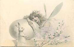 girl with wings to right of large egg, rabbit observes