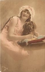 girl with frilly cap left of pekingese dog on pillow faces partly right & looks up to left