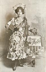 "girl stands ""dressed in postcards"""