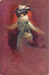 elegantly dressed woman with flowing skirt, elaborate hat with ostrich feather, fur scarf & muff stands facing right looking front/left, red/brown background