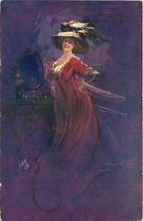 elegantly dressed woman with flowing skirt, elaborate hat with ostrich feather, stands by dressing table with mirror, hands behind her back,facing left, looking front, purple background