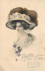 she faces left looks front wears very large hat dressed with ostrich feathers, filmy corsage of violets