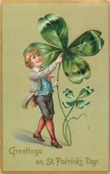 GREETINGS ON ST. PATRICK'S DAY  boy with exaggerated four leaf clover (no pig)