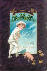 A HAPPY NEW YEAR  boy in white suit holds string to pigs foot, heavy purple border