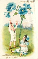 ALL GOOD WISHES FOR THE NEW YEAR girl sits in meadow holding exaggerated blue columbines, boy stands looking up at flowers
