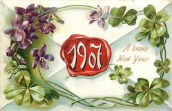 A HAPPY NEW YEAR 1907 in white at centre of red seal on back of envelope, violets & four leaf clovers  surround