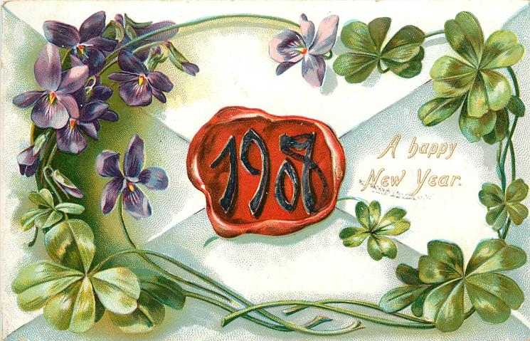 A HAPPY NEW YEAR 1908 in white at centre of red seal on back of envelope, violets &  four leaf clovers surround