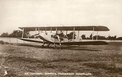 AN IMPERIAL AIRWAYS PASSENGER AEROPLANE, PRINCE HENRY  aircraft on airfield, facing front/left, 2 propellers with 4 blade each