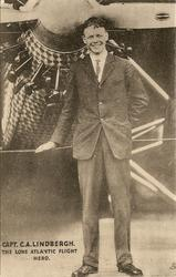 CAPT. C.A. LINDBERGH  hand on rope, plane close behind