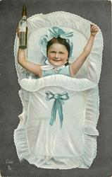 girl decked out as a baby, holding both arms in the air, bottle in right hand, tucked into a sleeping pouch