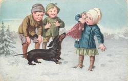dachshund  tugs at doll that young girl holds, two boys look on