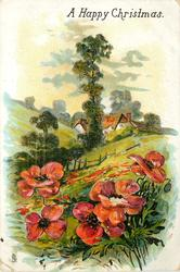A HAPPY CHRISTMAS red flowers front, hillside with trees & cottage behind