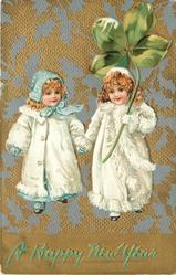 children, two girls in white with exaggerated four leaf clover