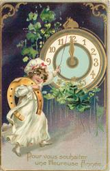 POUR VOUS SOUHAITER UNE HEUREUSE ANNEE  girl with horseshoe over right shoulder points at clock