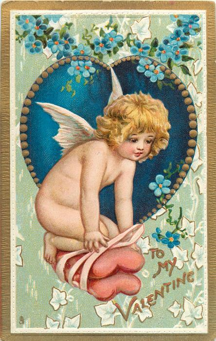 TO MY VALENTINE  cherub kneels on two heart shaped cushions held together with ribbon